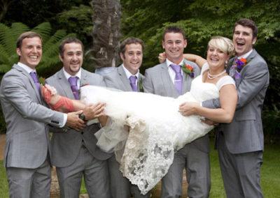 Men carrying bride - wedding photography in Dorset by Seven Springs Studios